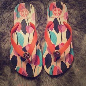 Tory Burch floral flip flops
